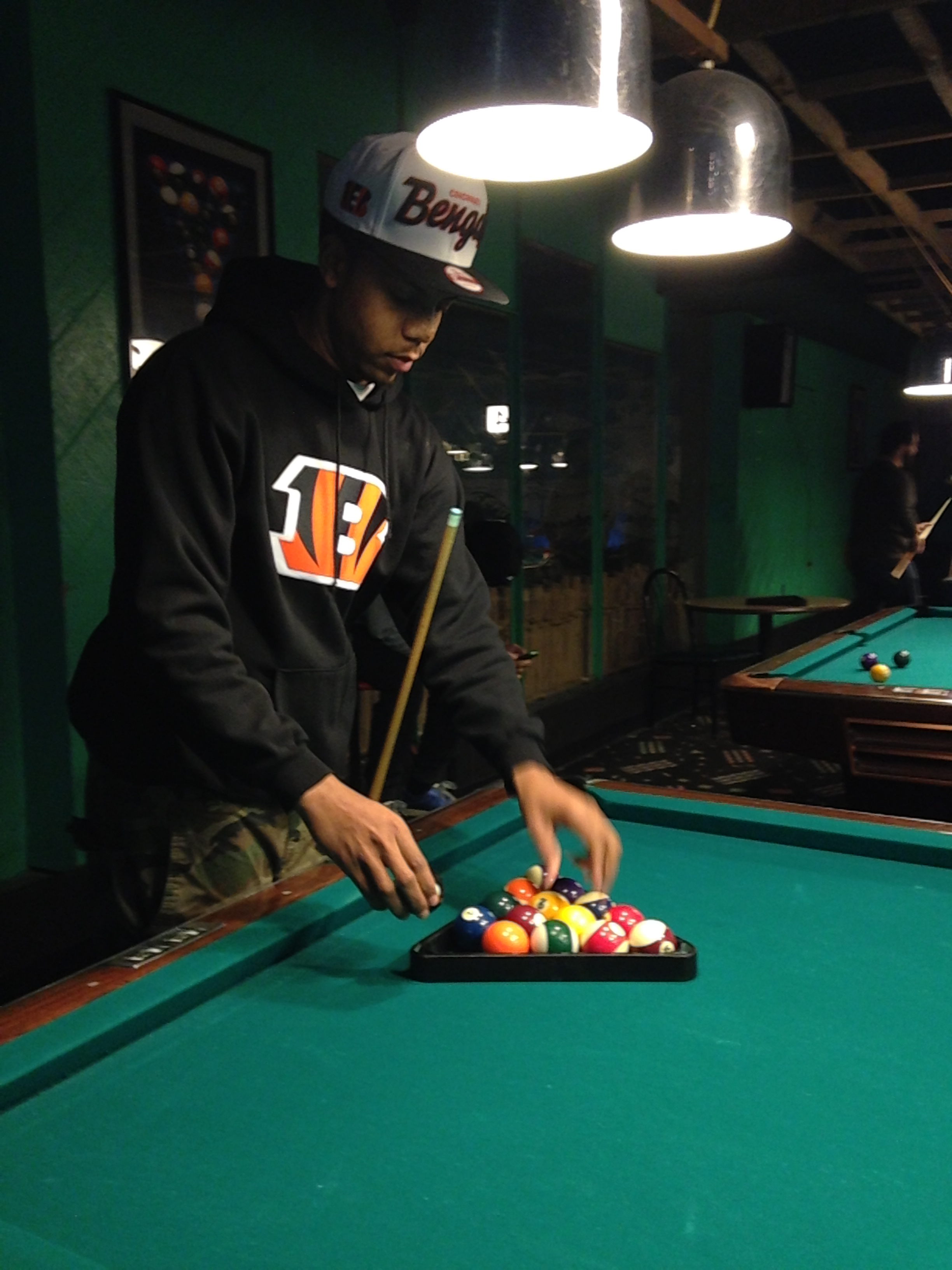 Dj J Dough preparing the pool table.