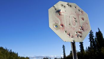 Stop sign riddled with bullet holes