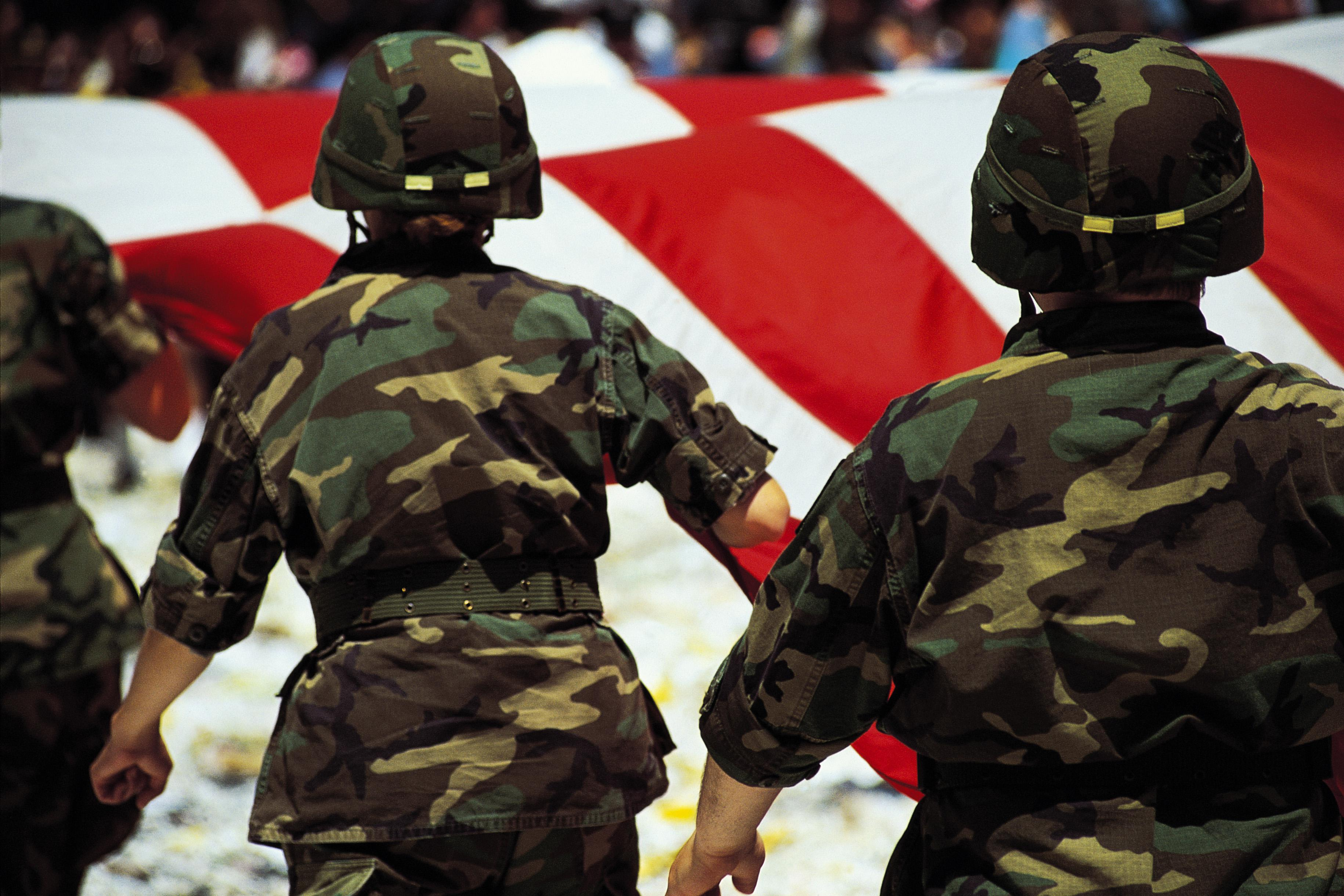 Soldiers with American flag in parade