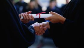 Graduate receiving a diploma, close-up of hands