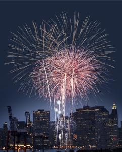 Fourth of July celebration over New York skyline at night