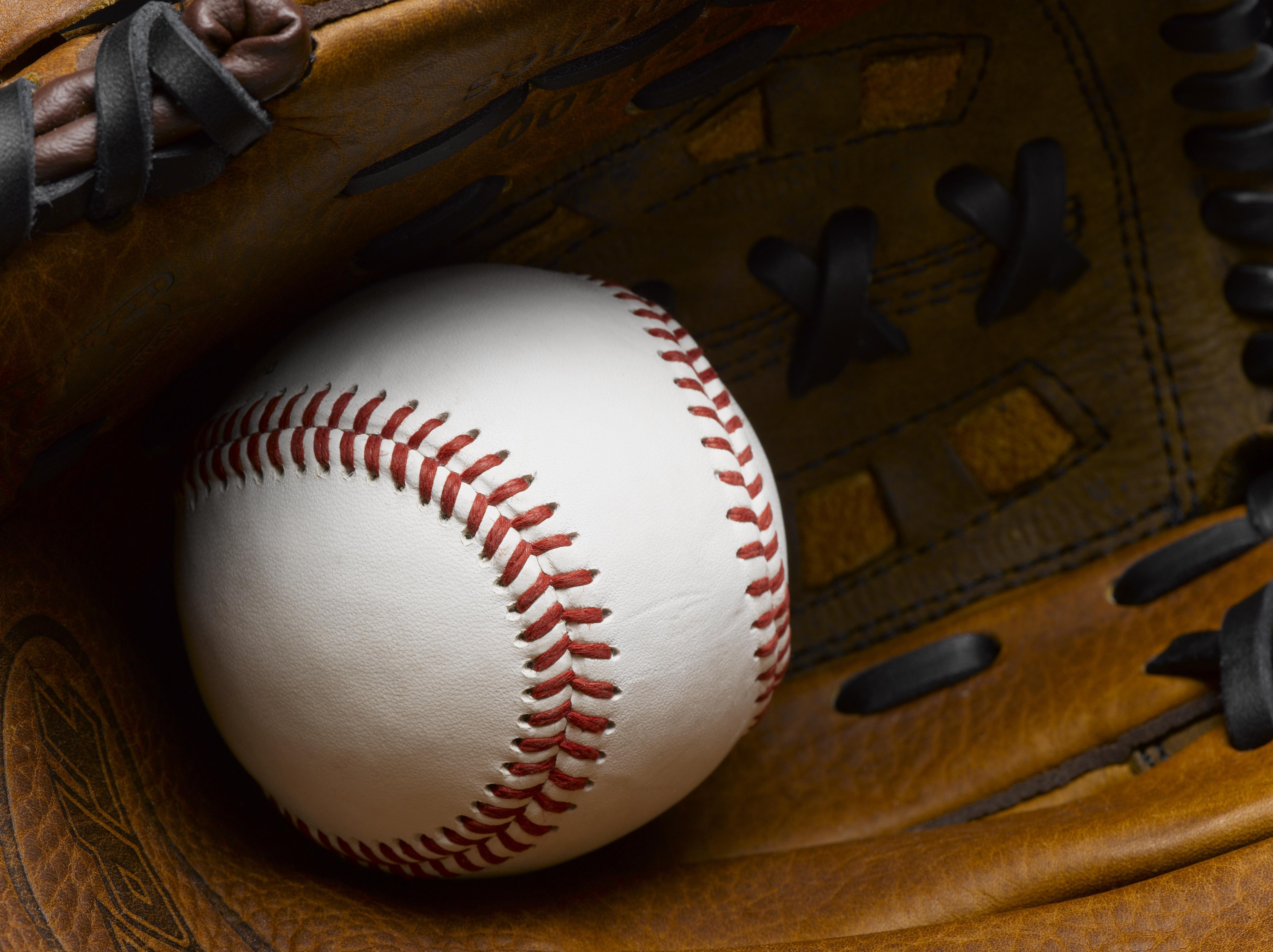 Baseball in glove close-up