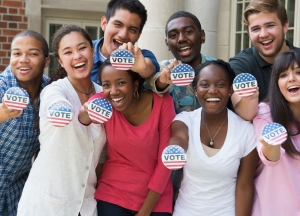 Students holding buttons at voter registration