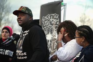Justice League Marchers Rally At Capitol Against Spate Of Police Violence