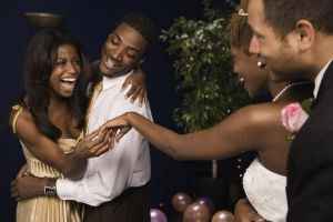 Bride showing wedding ring to friend