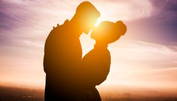 Diverse Couple Engagement Silhouettes at Sunset