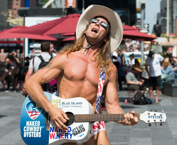 The Naked Cowboy watching for the solar eclipse as seen in...