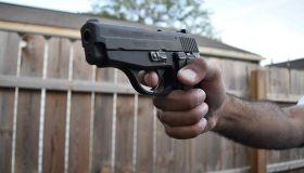 Man holding handgun pistol